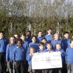 Pupils of Carbury N.S. Sligo Town presenting a cheque to FSRH for Cardiac Servics.