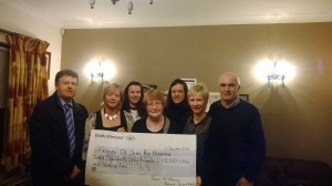 Mrs. Patricia McManus presenting a cheque to Mary Tighe Friends of SRH.
