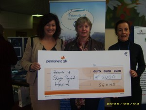 Deirdre Staunton from SGH MS presents a cheque for €5,000 to Mary Tighe and Jo Short of Friends of Sligo University Hospital
